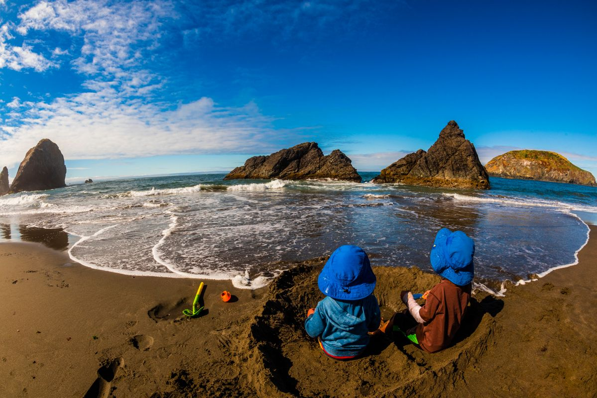 Children playing on the beach at Harris Beach State Park, Brookings, Oregon