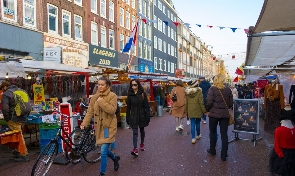 People shopping at Albert Cuyp Market in Amsterdam, Netherlands on Nov 29, 2019.