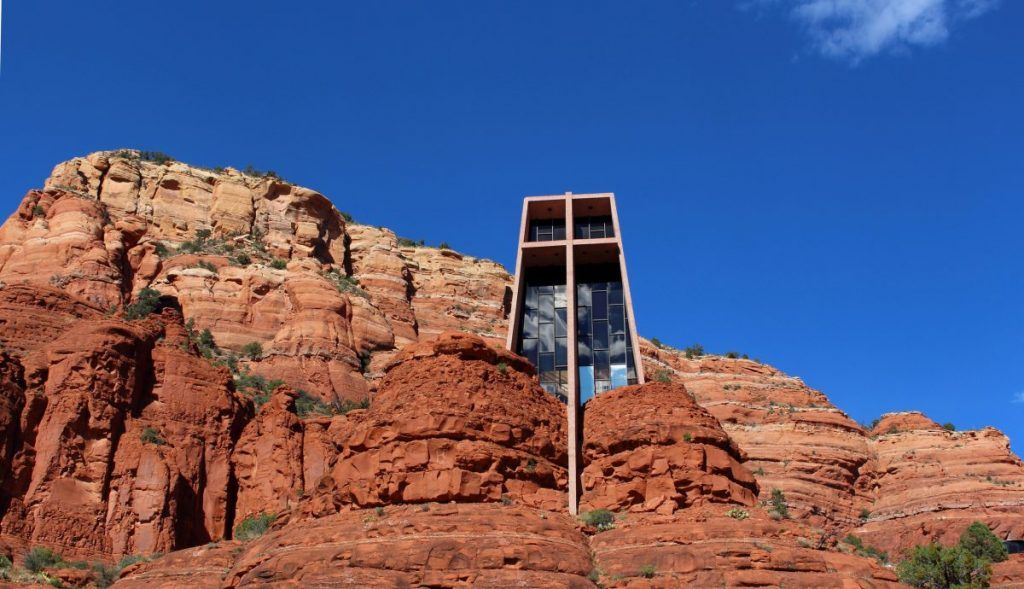 Chapel of the Holy Cross sitting on a plateau of red rock