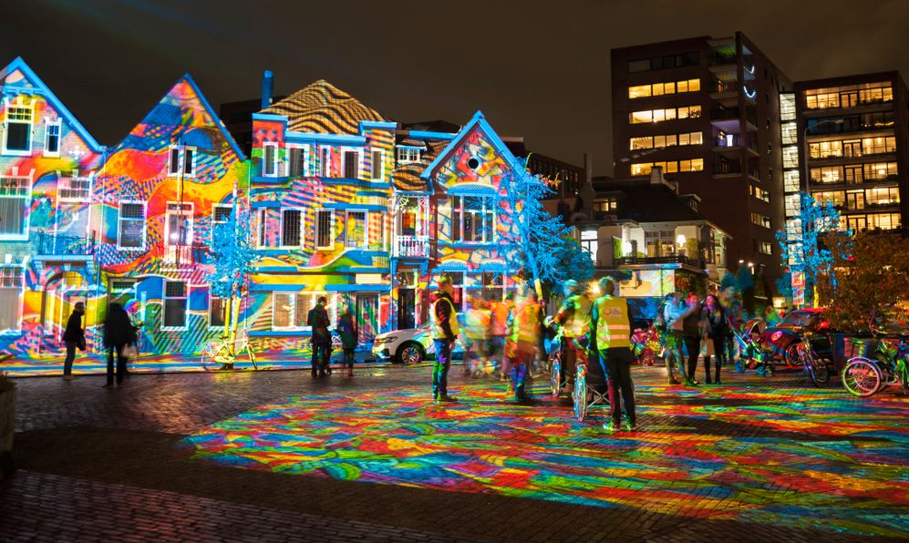 "Square Wilhelminaplein during light art festival ""Glow Eindhoven"" with artwork ""Diving in the sea of colors"" of Daniel Margraf."