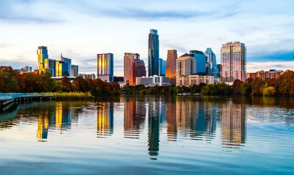 Lady Bird Lake mirrored skyline - Austin Texas