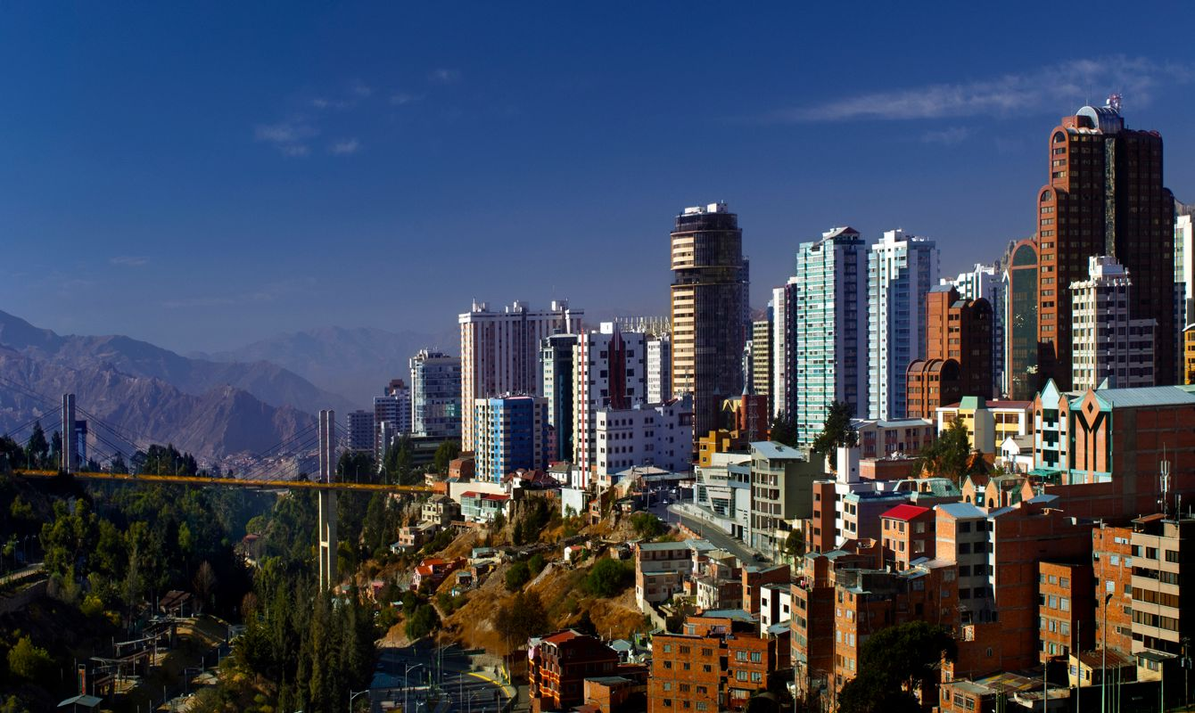 The skyline of the Sopocachi neighborhood in La Paz, Bolivia has some of the city's largest buildings.  La Paz is the world's highest de facto capital city at roughly 12,000 feet above sea level.