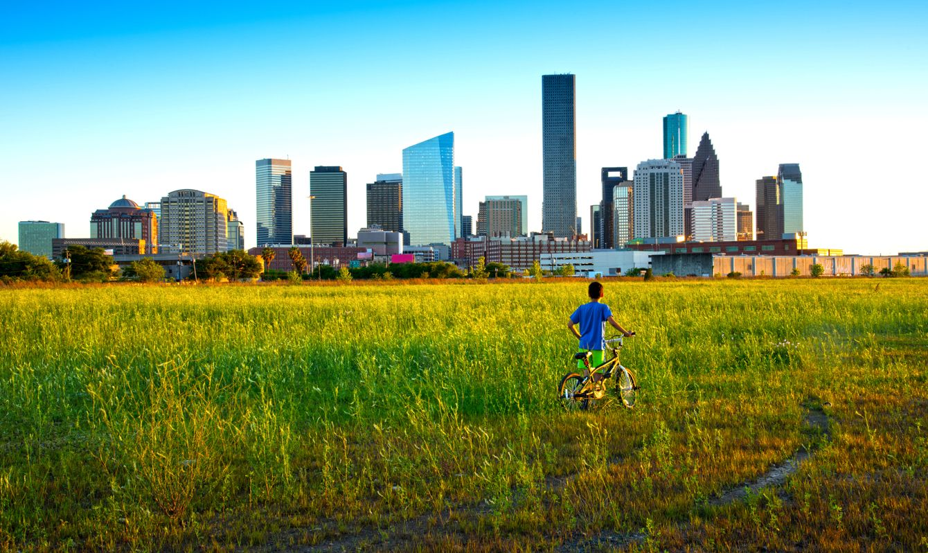 The Near Northside neighborhood of downtown Houston is developing into prime real estate because of its location to the city. Many families of Mexican heritage currently populate the district. A young Mexican boy looks toward the imposing skyline of Houston.