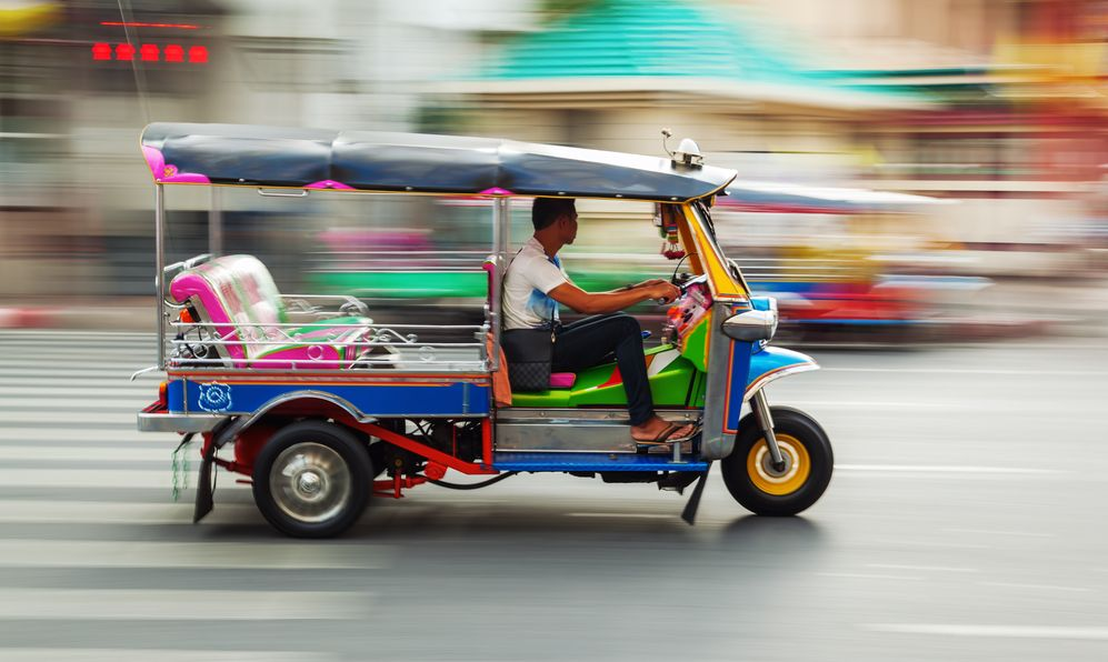 raditional tuk-tuk from Bangkok, Thailand, in motion blur