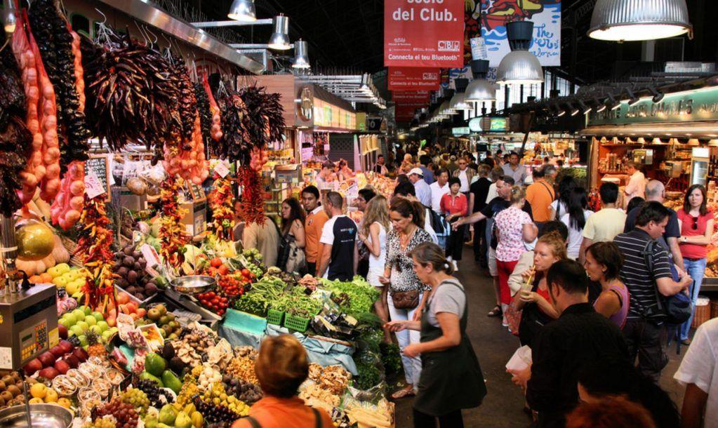 Tourists in famous La Boqueria market
