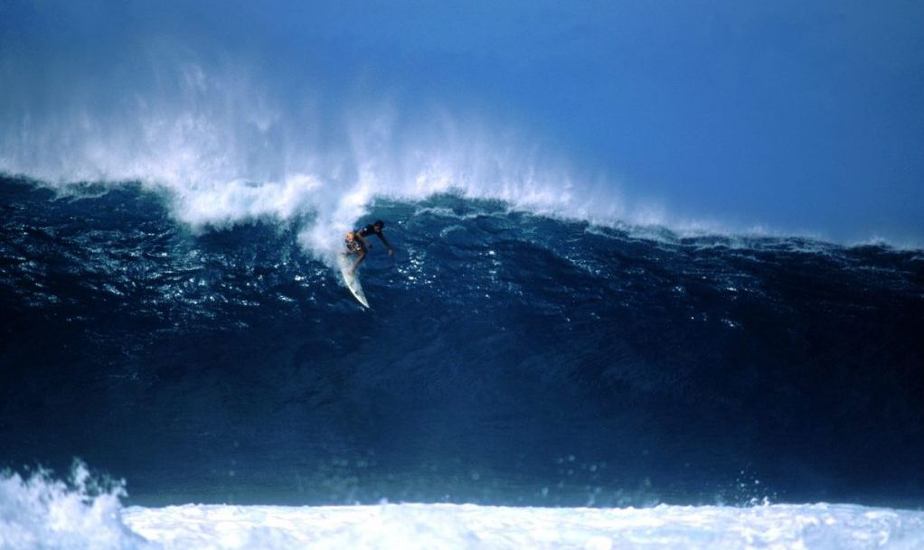 Waimea surfing waves
