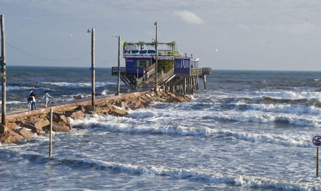 Galveston fishing pier sat on the wavy waters
