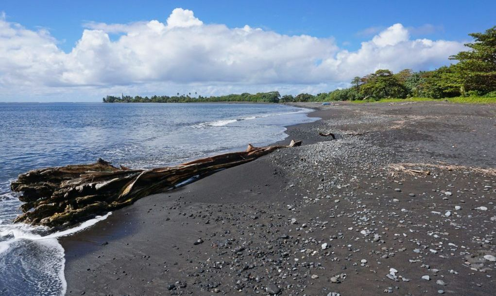 Black sand beach Tahiti island French Polynesia