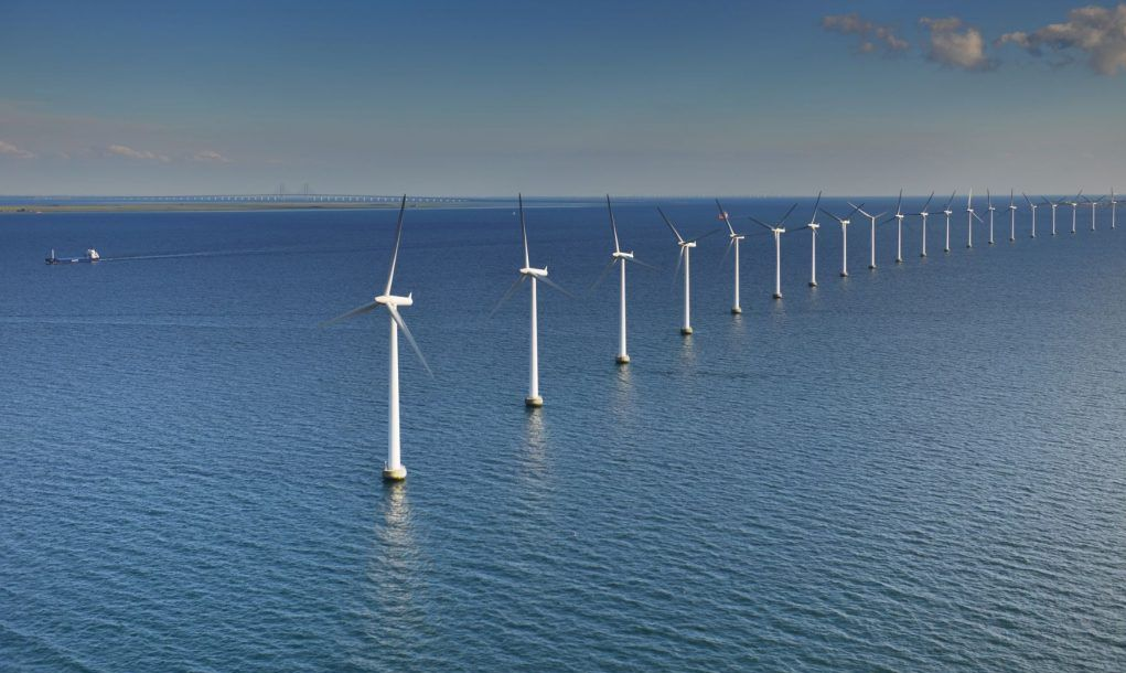 Middelgrunden Wind Turbine Offshore wind park and the Oresund Bridge in the background in Oresund outside Copenhagen, Denmark