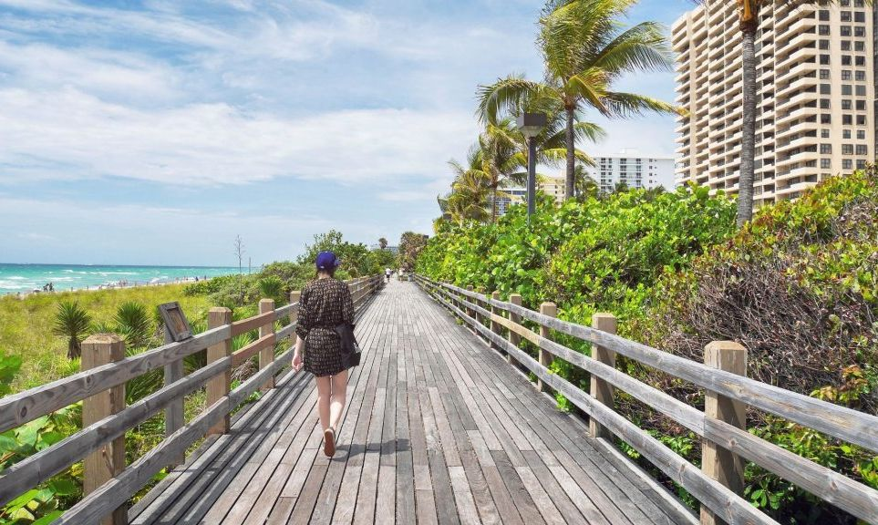 a girl walking on the boardwalk in Miami