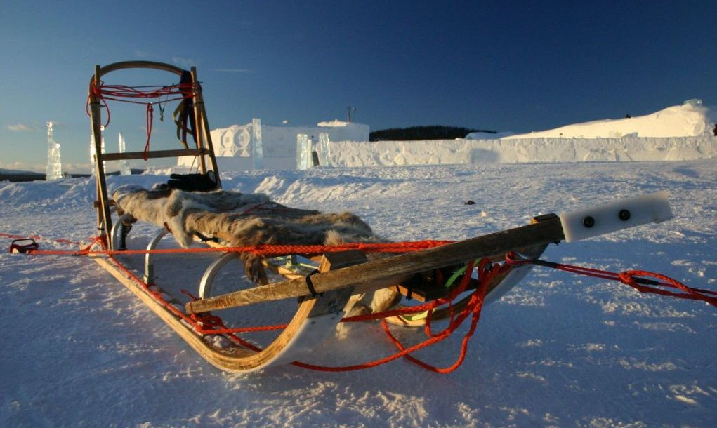 Empty dogsled lying outside the ice hotel in Lapland, Sweden