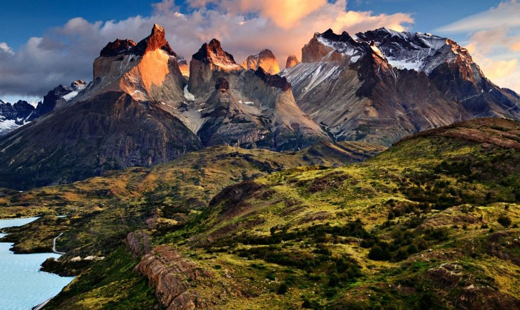 "An early morning sunrise landscape photograph of the Cuernos del Paine, or ""Horns of Paine"", a world-famous mountain range in Patagonia and the Andes."