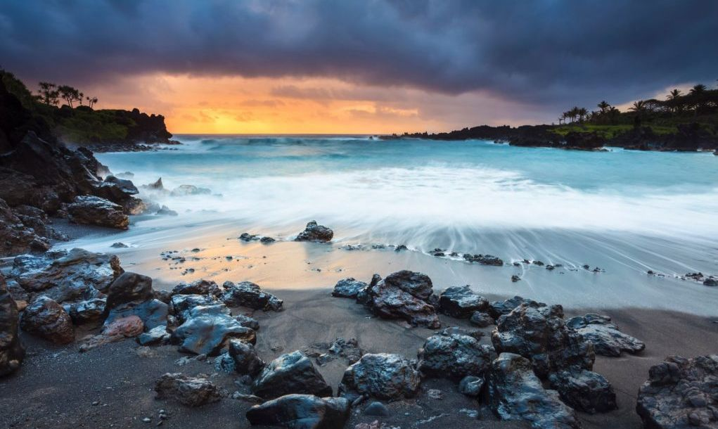 Early morning at Maui's only volcanic black sand beach, in Wai'anapanapa State Park, located off the Hana Highway.