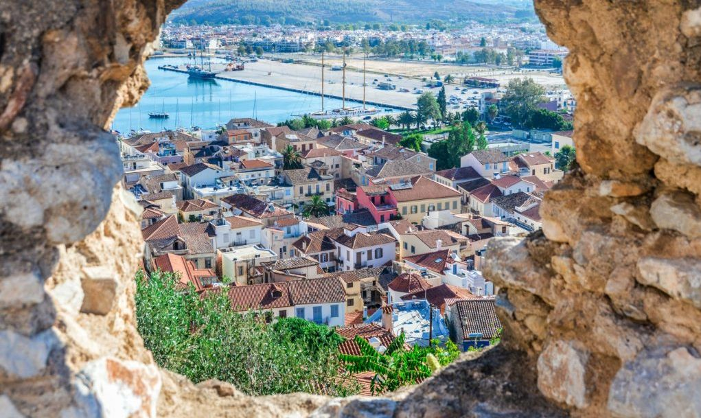 Old town of Naflio, Greece through stone window