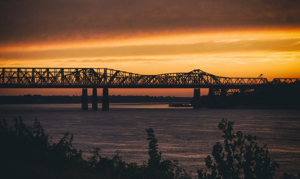 Sunset over the Mississippi River and Harahan Bridge in Memphis, TN.