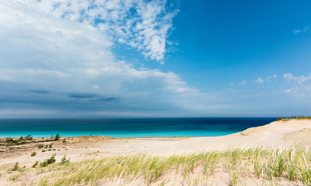 Azure blue skys and the waters of Lake Michigan are the background at Sleeping Bear Dunes National Lakeshore in Glen Haven Michigan