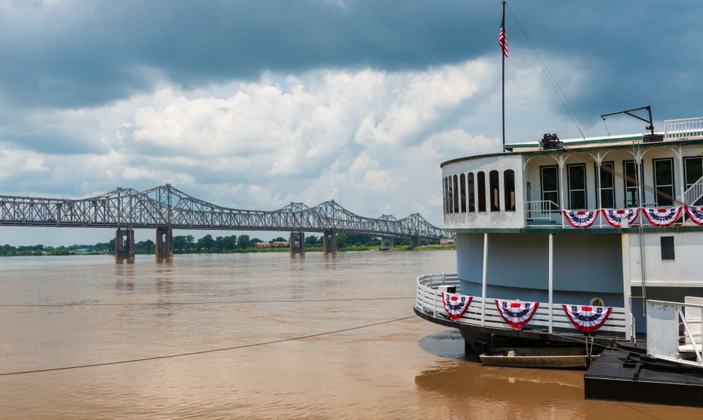 Detail of a steamer boat and the bridge over the Mississippi River near the city of Natchez, Mississippi