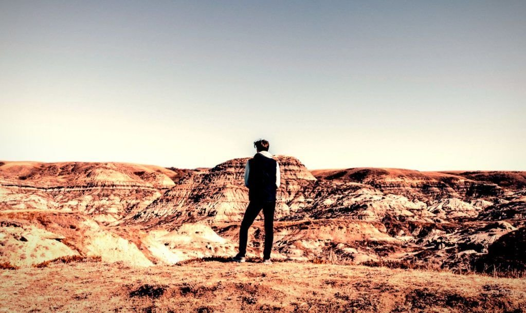 Marveling at Expansive View of Prehistoric Landscape at Drumheller, Alberta, Canada