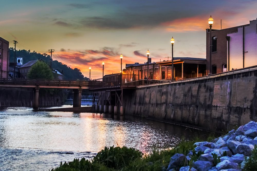 Creekwalk and dam waterfall in Prattville, Alabama at dusk