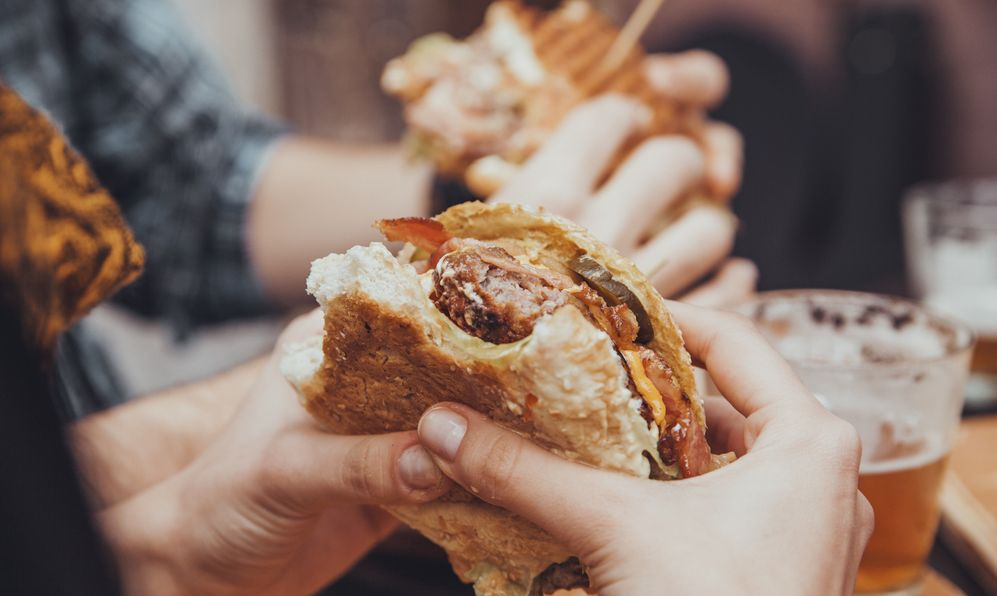 Close Up Of Woman Hands Holding Delicious Burger