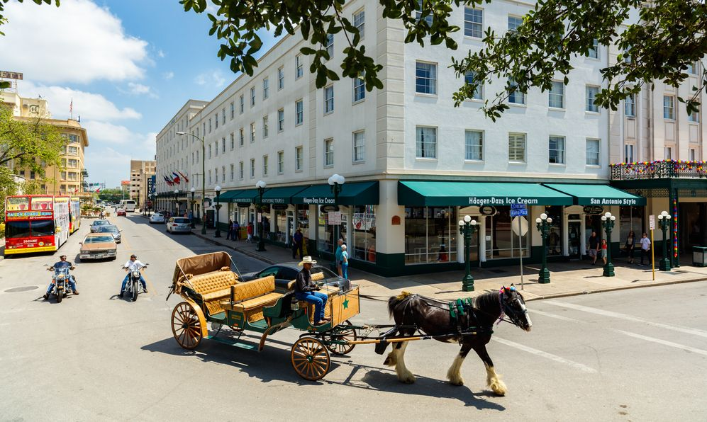 A classic horse carriage ride in the downtown historic Alamo district.
