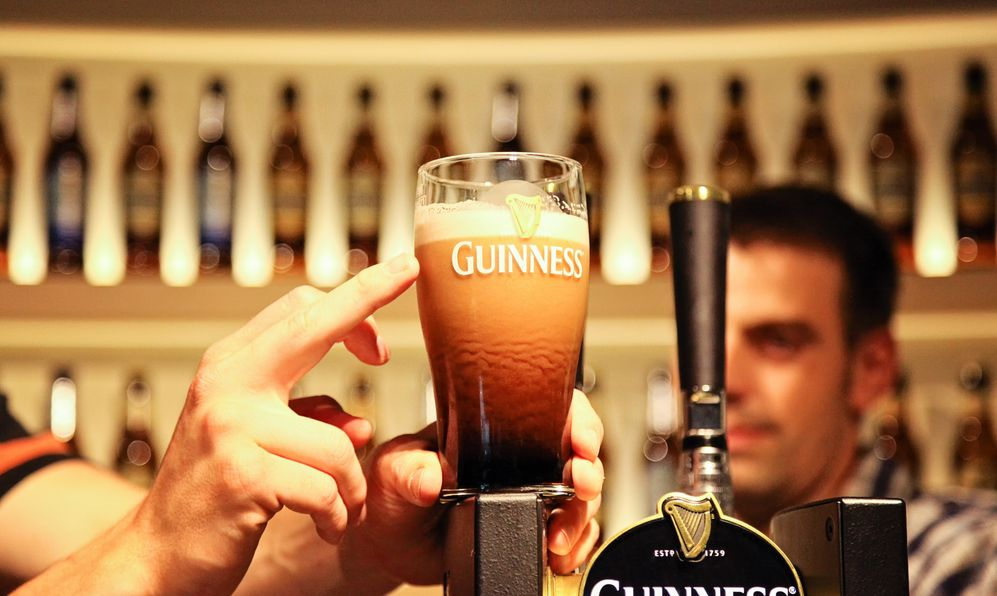Pint of guinness placed on top of draft counter at Guinness Storehouse Brewery