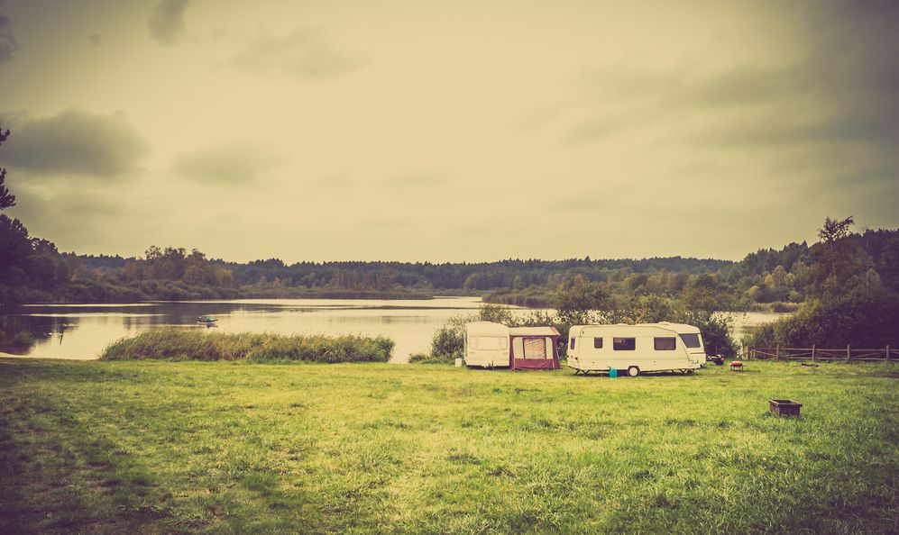 Caravan camping on the lake in the summer vacation