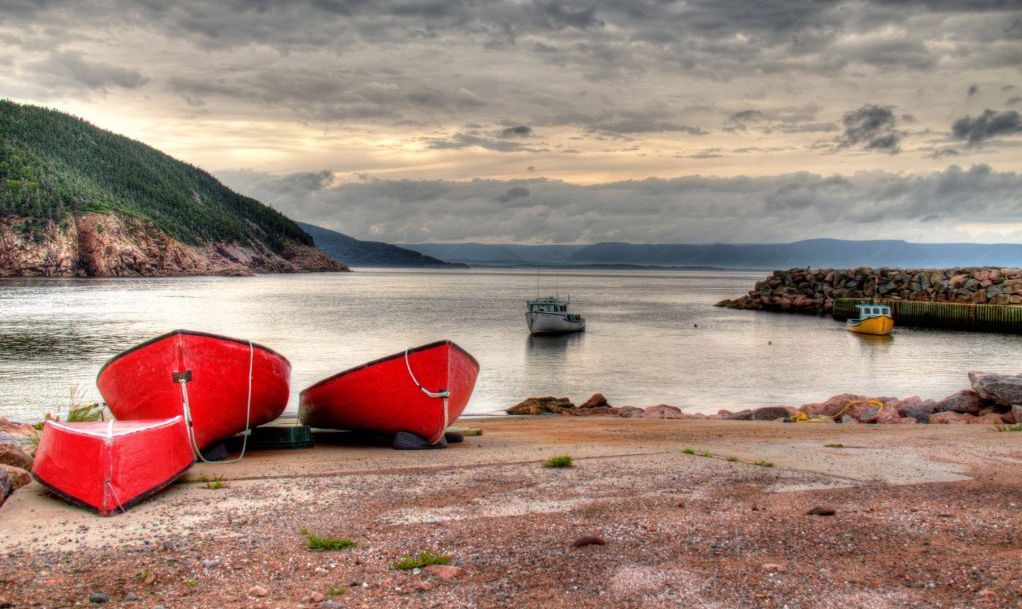 Red Fishing Boats on in a little fishing village on the shores of Cabot Trail, Cape Breton Island, Nova Scotia, Canada
