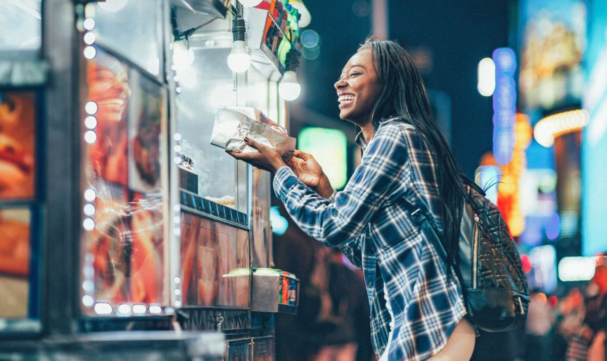 Africa American Woman at a Hot Dog Stand