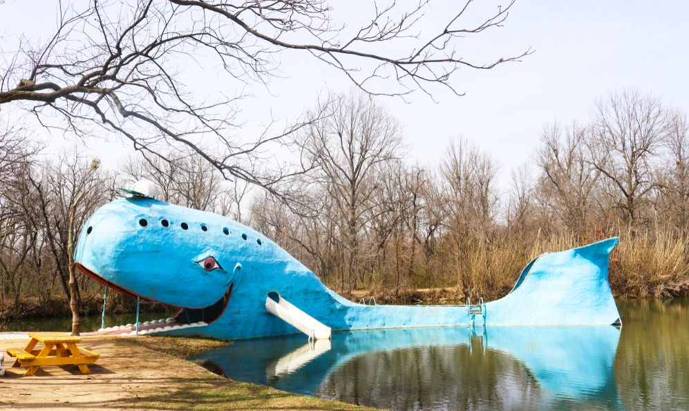 Iconic huge Blue Whale roadside attraction by swimming hole on Route 66 in Oklahoma on a winter day