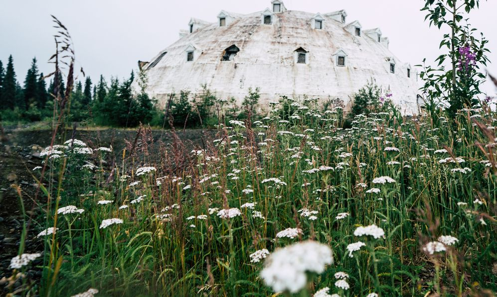 An abandoned Igloo Hotel, formerly known as Igloo City, sits empty along the George Parks Highway in Alaska