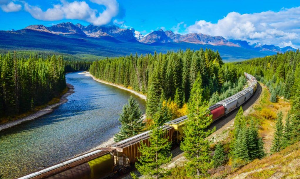 Long freight train moving along Bow river in Canadian Rockies ,Banff National Park, Canadian Rockies,Canada.