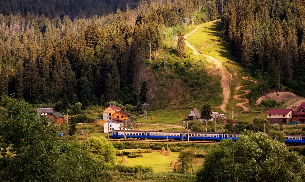 blue train in mountains. natural summer background