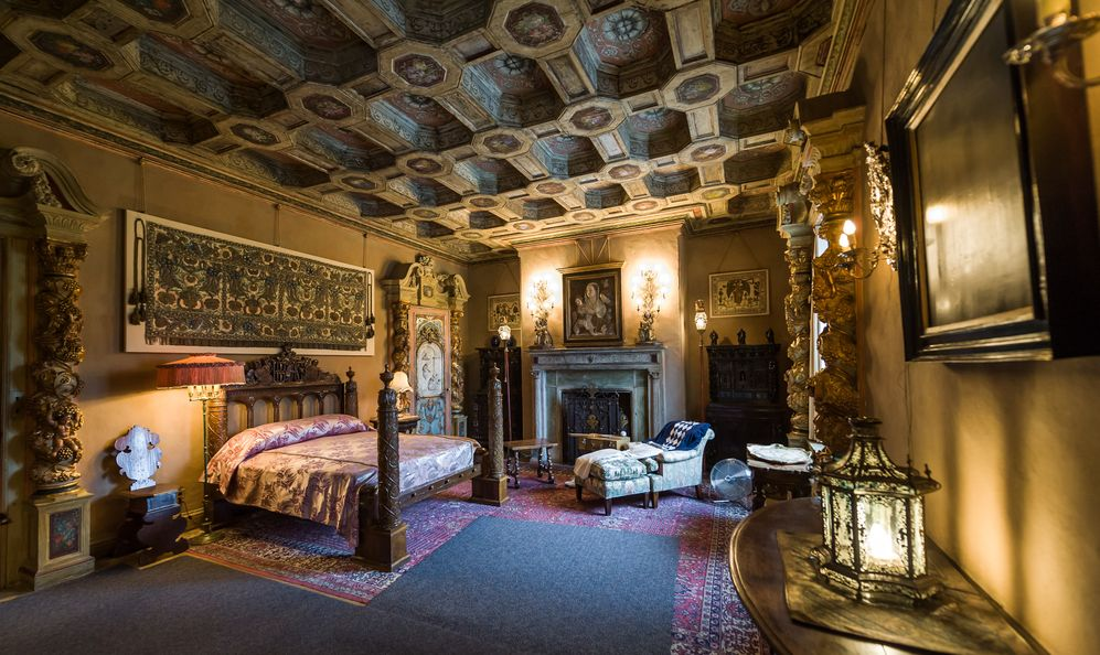 Beautiful and luxurious bedroom with inctricate carvings and designs at Hearst Castle, which is a National and California Historical Landmark opened for public tours
