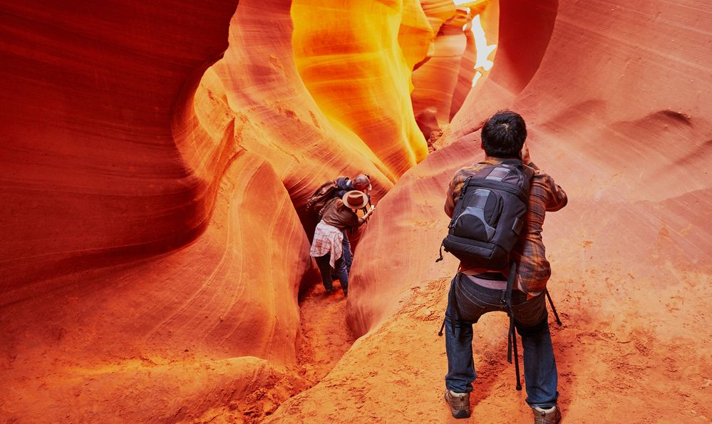 Tourist taking photo in Lower Antelope Canyon in the Navajo Reservation near Page, Arizona, USA