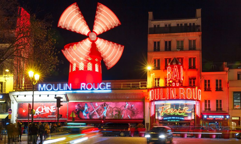 The picturesque famous cabaret Moulin Rouge located close to Montmartre in the Paris red-light district of Pigalle on boulevard Clichy at night