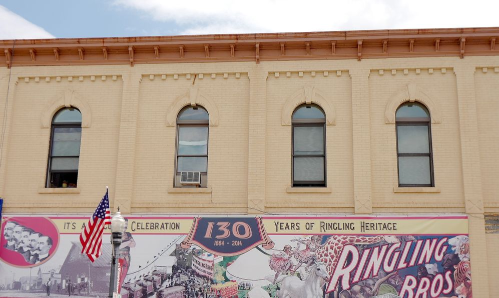 Exterior brick building, Banner celebrating 130 years of Ringling Brothers Heritage