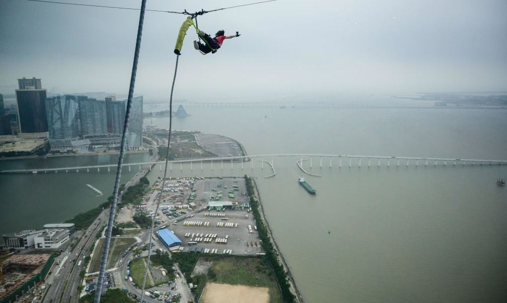 A person taking part in a 233meters / 764feet high bungee jump off the Macau Tower in Macau, the highest commercial bungee jump in the world, according to Guinness World Records.