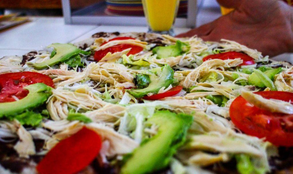 A Tlayuda, also known as a Oaxacan Pizza