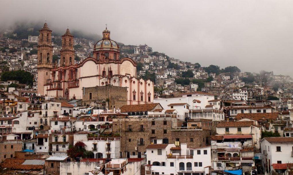 Hazy view of Santa Prisca church in Taxco de Alarcon, Guerrero, Mexico.