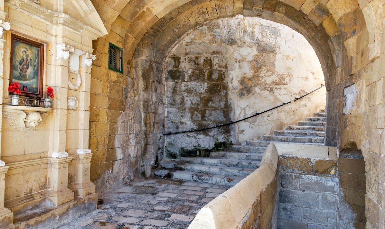 Old medieval stone passage way in historic Senglea, Malta