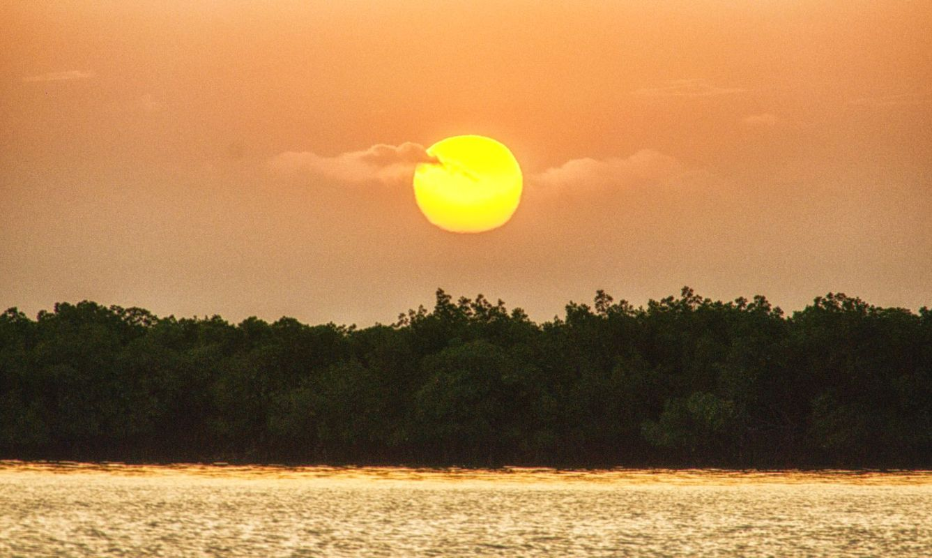Beautiful and peaceful sunset over calm Gambia river, The Gambia, West Africa