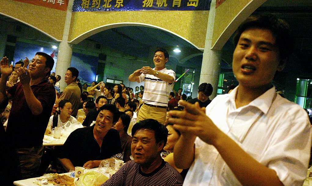 Visitors cheer drinking contestants in a beer hall at the 13th Qingdao International Beer Festival August 17, 2003 in Qingdao, China, home of Tsingtao beer factory. The annual 17 day festival, which marks its centennial this year, is modeled after the Octoberfest in Munich, and draws crowds of local and foreign visitors as well as overseas manufacturers from Europe and the U.S. Tsingtao beer is China's number one beer producer and was founded in 1903 by German expatriates.