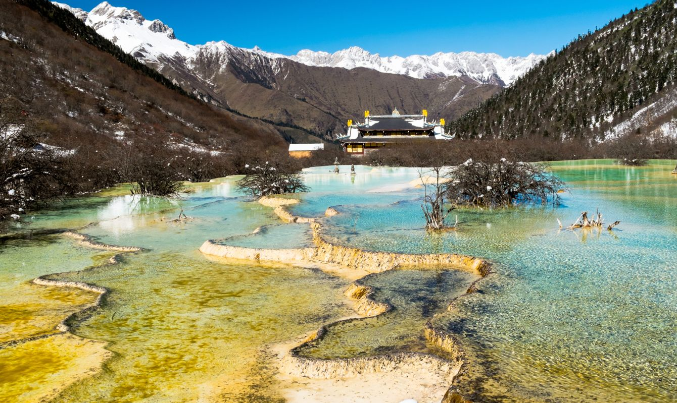 The ancient temple and the five colour lakes landmark the famous Huanglong, Sichuan province, China.