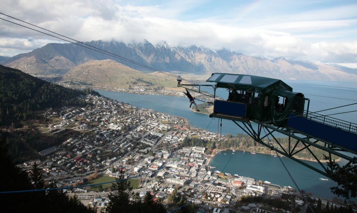 Aerial view of Queenstown and Lake Wakatipu with Bungee Jumping, and the Remarkables mountain range behind, New Zealand