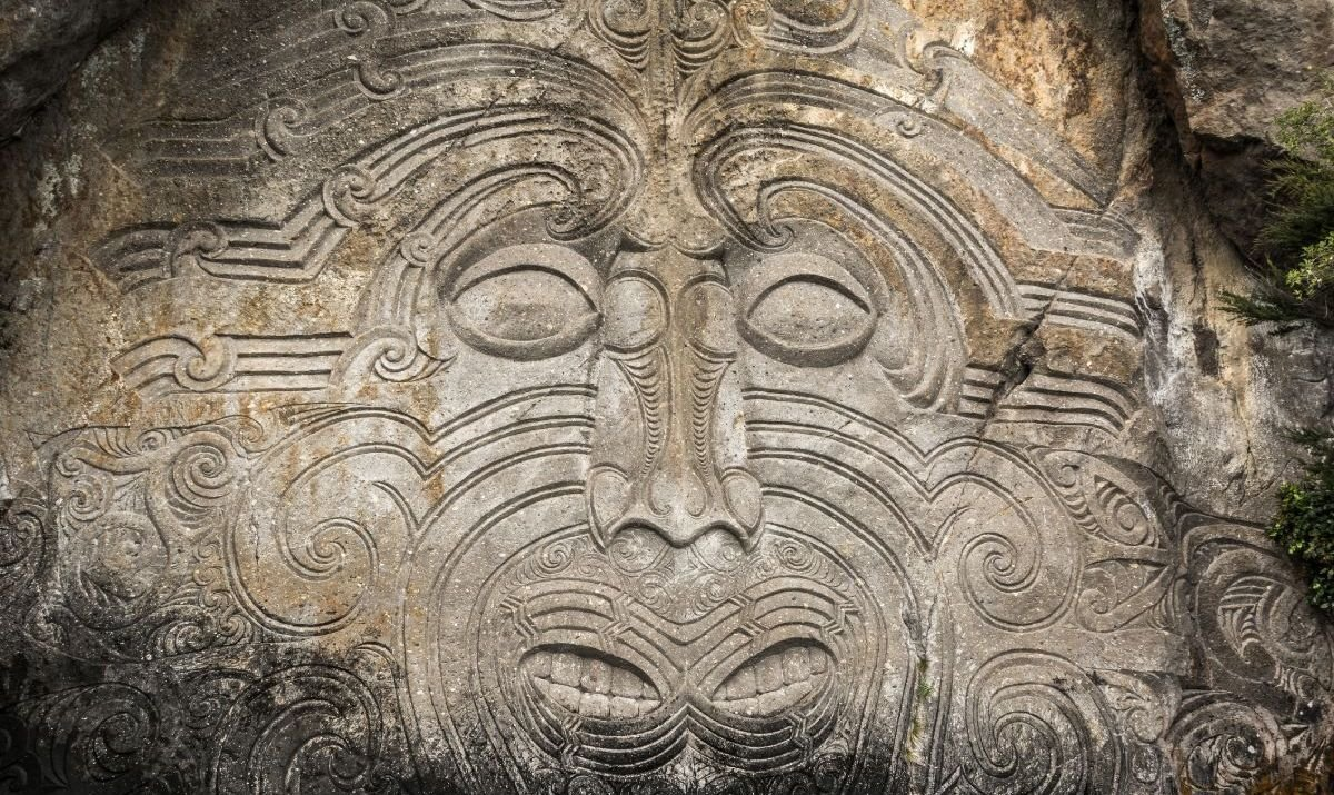 Maori rock carvings located by the water at Lake Taupo in New Zeland. The carvings feature A big face, Maori style figurines and several animals such as crocdiles and birds. The carvings are accessable only by boat or a kayak.