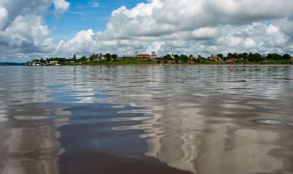 Guyana, Mazaruni river. View from river to river bank with Mazaruni Prison