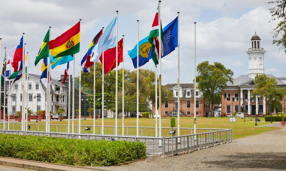 Independence Square with the flags of the Caribbean Community and Common Market