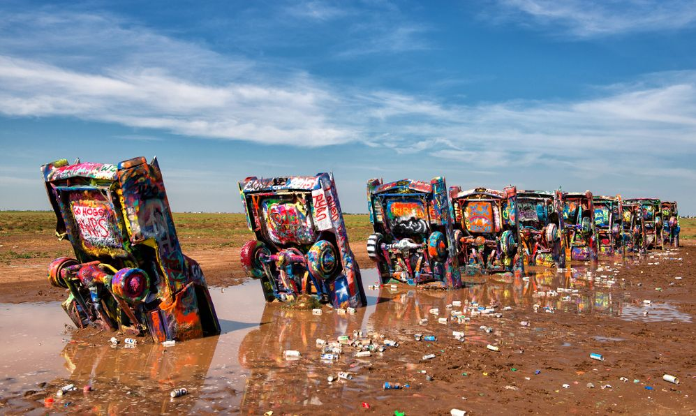 he Cadillac Ranch. Famous sculpture of half-buried Cadillac-cars that was created in 1974 by Chip Lord, Hudson Marquez and Doug Michels.