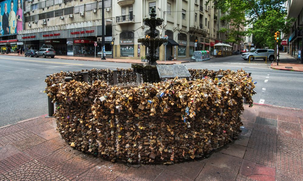 Love Locks Fountain in Montevideo is a stone fountain on a street corner in Montevideo, the hundreds of padlocks attached to its surrounding railing